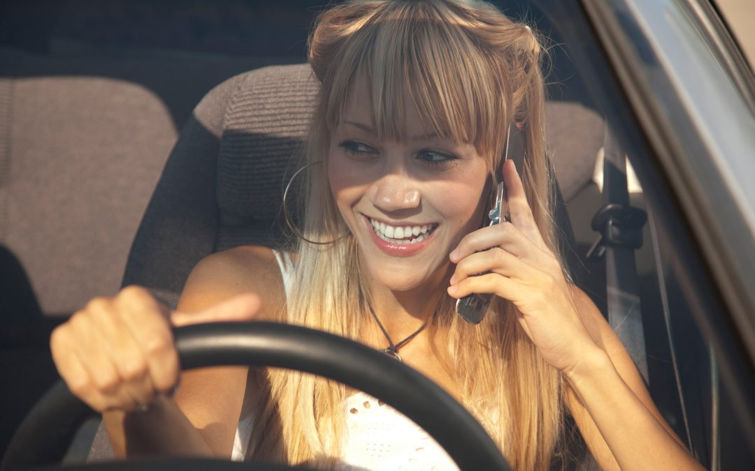 Is it an offence to use a mobile phone whilst driving?