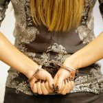 female in cuffs